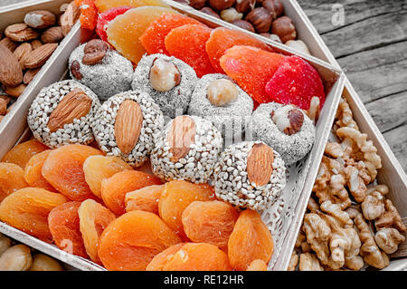 Turkish delight oriental sweets dried fruits and nuts in a wooden box. Background. Healthy vegan food. Natural food. Selective focus. - Stock Photo