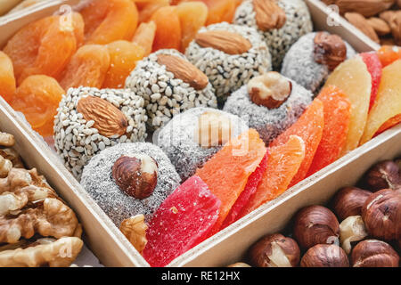 Eastern sweets dried fruits and nuts in a wooden box. Background. Healthy vegan food. Natural food. - Stock Photo