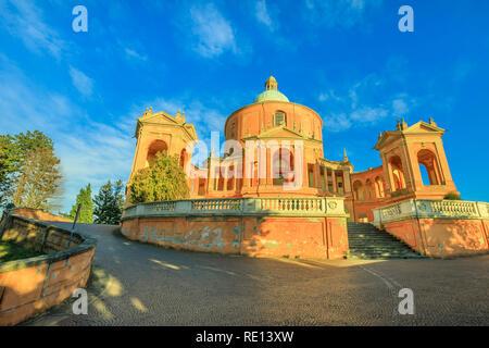 Pronaos and facade of the Sanctuary of Madonna di San Luca at sunset. Basilica church of San Luca in Bologna, Emilia-Romagna, Italy with blue sky. Famous landmark cityscape. Copy space. - Stock Photo