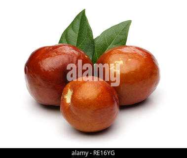 Fresh jujubes and leaves isolated on white background - Stock Photo
