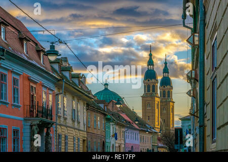 A beautiful street and Holy Trinity Cathedral at sunset in Sibiu, Romania. - Stock Photo