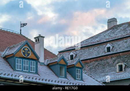 Traditional medieval houses covered with snow in Sibiu, Romania. - Stock Photo