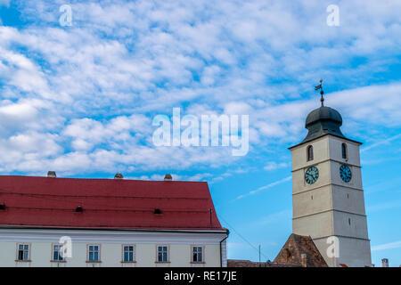 View to the Sibiu's council tower towards a blue sky in Sibiu, Romania. - Stock Photo