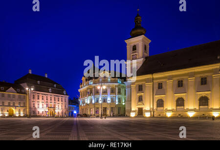 The Big Square with the Citty Hall in Sibiu at night in Transylvania region, Romania. - Stock Photo