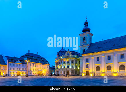 The Big Square with the Citty Hall in Sibiu at sunrise in Transylvania region, Romania. - Stock Photo