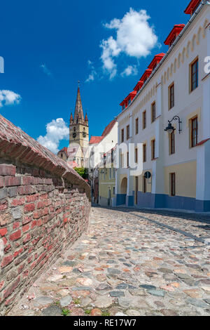 Sibiu, Romania - Beautiful street with Lutheran Cathedral of Saint Mary on a sunny summer day with blue sky in Sibiu, Romania. - Stock Photo