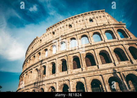 The ancient Colosseum in Rome at sunset - Stock Photo