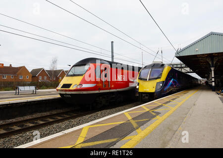 LNER Class 43, 43305, and First Hull Trains, Class 180 Adelante waiting at the platform, Grantham railway station, Lincolnshire, England - Stock Photo