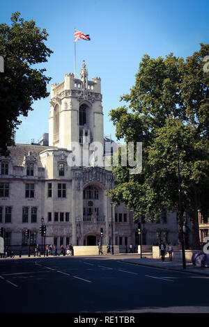 People passing the Middlesex Guildhall at Parliament Square in London, which houses the Supreme Court of the United Kingdom - Stock Photo