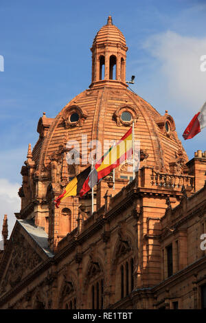 European flags waving from the rooftop of the Harrods department store in London, United Kingdom - Stock Photo