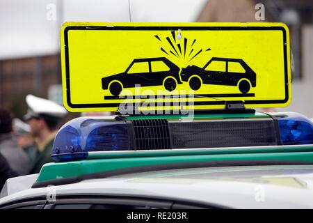 Warning sign on a police patrol car, drawing attention to a traffic accident, Duesseldorf, North Rhine-Westphalia - Stock Photo