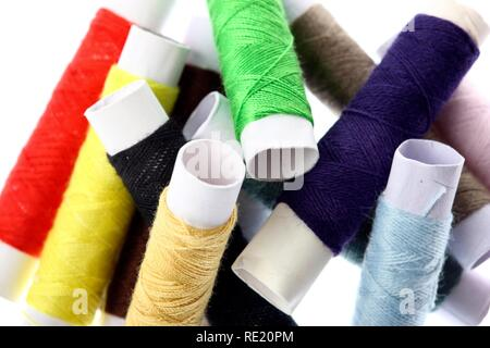 Different coloured sewing cotton reels - Stock Photo