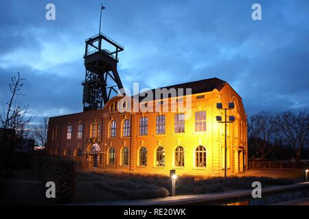 Steigerhaus mine building and shaft tower of the former colliery and coking plant Osterfeld, now Olga-Park amusement park - Stock Photo