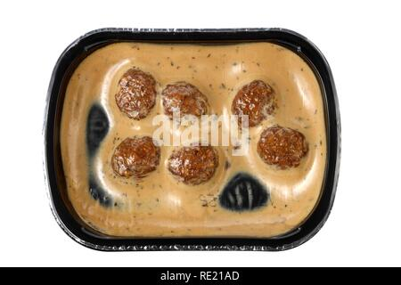Meal in a plastic container, pre-cooked, portioned for one person, meatballs in cream sauce - Stock Photo