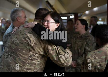 Mrs. Ricki Selva, wife of U.S. Air Force Gen. Paul J. Selva, vice chairman of the Joint Chiefs of Staff, hugs a U.S. service member at Kandahar Airfield, Afghanistan, Nov. 24, 2016. Gen. Selva and Mrs. Selva visited troops across Afghanistan to spend Thanksgiving Day with them and thank them for their service. - Stock Photo