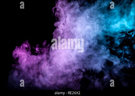 Clouds of isolated colored smoke: blue, red, green, pink; scrolling on a black background in the dark close up. - Stock Photo