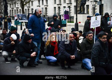 London, UK. 19th January, 2019. A sit down protest opposite Downing Street by demonstraters from the  London Kurdish community  in support of jailed Kurdish politician Leyla Güven who is on hunger strike. Credit: Claire Doherty/Alamy Live News - Stock Photo