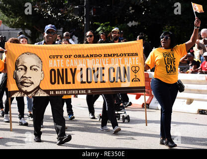 Florida, USA. 19th Jan 2019. People march in the annual Dr. Martin Luther King, Jr. Day Parade on January 19, 2019 in Orlando, Florida. (Paul Hennessy/Alamy) Credit: Paul Hennessy/Alamy Live News
