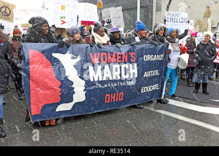 Cleveland, Ohio, USA, 19th January, 2019.  The much anticipated winter storm Harper made its appearance in downtown Cleveland as the 2019 Women's March made its way through the streets of Cleveland. Credit: Mark Kanning/Alamy Live News. - Stock Photo
