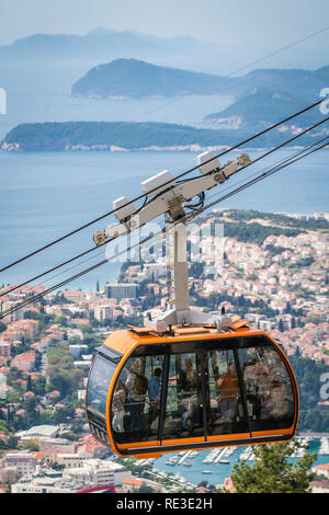 Dubrovnik, Croatia - April 2018 : Dubrovnik cable car, a popular tourist attraction taking people on the top of a Mount Srd above the historical Old T - Stock Photo