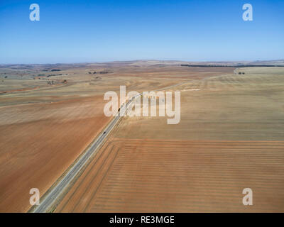 Goyder Highway passing through rural landscape of harvested wheat fields near Spalding South Australia - Stock Photo