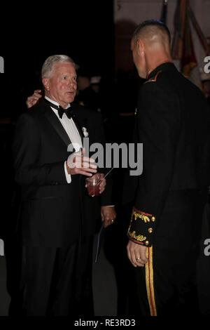 Col. Robert Cooper (right) greets retired Gen. James F. Amos (left) at Marine Aircraft Group 31's Marine Corps Birthday Ball aboard MCAS Beaufort, Nov. 9. Amos was the 35 Commandant of the Marine Corps and the guest of honor at MAG-31's ball. Cooper is the Commanding Officer of MAG-31. - Stock Photo