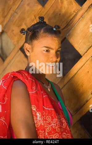 Young Malagasy woman portrait, Morondava, Madagascar, Africa - Stock Photo