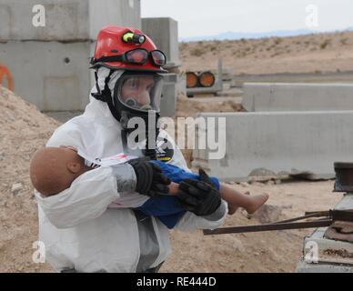 Nevada Army Guard Spc. Benjamin Vance, of the Nevada National Guard's CERFP (Chemical, Biological, Radiological, Nuclear and Explosive Enhanced Response Force Package) trains for disaster response relief on Nov. 16 during Vigilant Guard 2017 in North Las Vegas. VG 17 was the first of four joint operational disaster readiness exercises this year hosted by U.S. Northern Command. Last week's exercise involved multiple local, federal and state agencies including the city of North Las Vegas, the Nevada and California national guards and the Nevada Division of Emergency Management. - Stock Photo