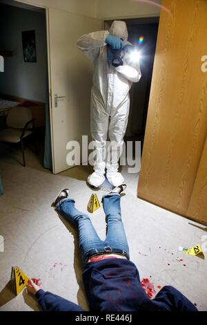 Photographic securing of forensic evidence, officers of the C.I.D., the Criminal Investigation Department, gathering forensic - Stock Photo