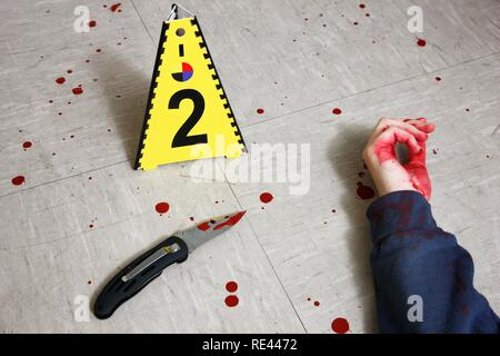 Securing forensic evidence at a crime scene after a capital offence, homicide, by the C.I.D., the Criminal Investigation - Stock Photo