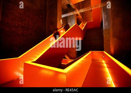 Red illuminated main staircase in the new Ruhrmuseum museum, opened in January 2010, Capital of Culture year, in the former coal - Stock Photo