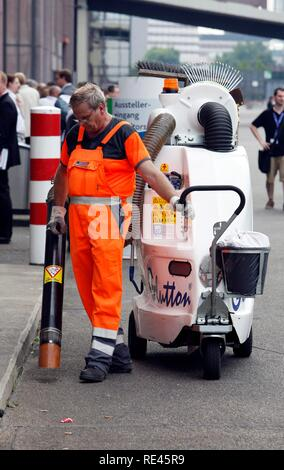 Street-cleaning with a portable vacuum, Cologne, North Rhine-Westphalia - Stock Photo