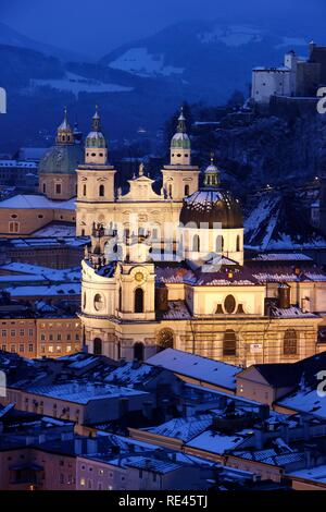 Old town with the Kollegienkirche church, the cathedral and Festung Hohensalzburg fortress, in the evening, winter, Salzburg - Stock Photo