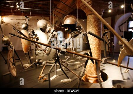 Display of medieval weapons and armors in the Festungsmuseum fortress museum, Festung Hohensalzburg fortress, Salzburg, Austria - Stock Photo