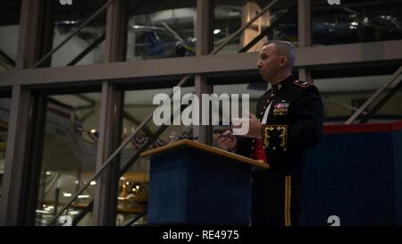 """Retired U.S. Marine Corps Col. Randy """"Komrade"""" Bresnik, speaks at the 241st Marine Corps Ball, at the National Naval Aviation Museum, in Pensacola, Florida, Nov. 19, 2016. Bresnik during his Marine Corps career, flew 82 different aircraft. He was selected by NASA to be an astronaut, conducted space walks and will command the next mission to the International Space Station in 2017. Bresnik will be the first Marine to ever visit and stay at the ISS. - Stock Photo"""