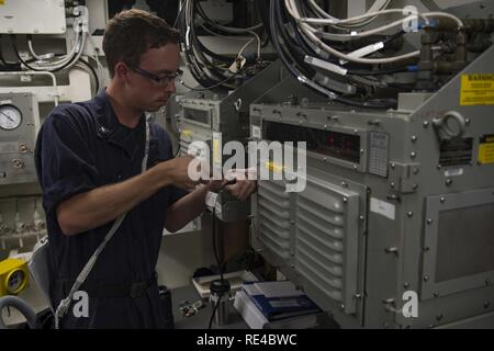 ARABIAN GULF (Nov. 21, 2016) Petty Officer 3rd Class Joshua Peck, assigned to the guided-missile destroyer USS Nitze (DDG 94), conducts fiber-optic data multiplexing system maintenance. Peck serves onboard Nitze as an electronics technician and is responsible for maintaining, repairing and calibrating shipboard electronic equipment. Nitze, deployed as part of the Eisenhower Carrier Strike Group, is supporting maritime security operations and theater security cooperation efforts in the U.S. 5th Fleet area of operations. - Stock Photo