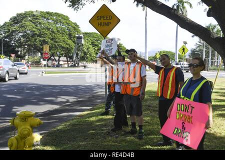 PEARL HARBOR (Nov. 23, 2016) Service members rally at the Joint Base Pearl Harbor-Hickam gates to remind drivers to not drink and drive, Nov. 23. Petty Officer 2nd Class Shaylee Stewart organized the event partnering with Master Chief Suz Whitman, U.S. Pacific Fleet Master Chief, and JBPHH organizations Coalition of Sailors Against Destructive Decisions, Airmen Against Drinking and Driving, Chief Petty Officer 365 and the command's Drug and Alcohol Program advisors. - Stock Photo