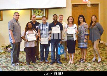 Several delegates from this year's AFAP conference pose for a photo with their Certificates of Achievement on the last day of the conference, at the Nehelani, Nov. 16. - Stock Photo