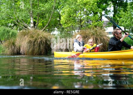 CHRISTCHURCH, NEW ZEALAND - OCTOBER 10 2018; Family  of three enjoyng time kayaking on Avon River. - Stock Photo