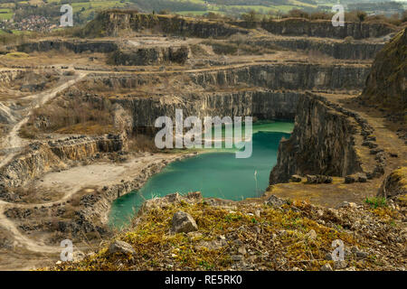 This is a disused quarry located near Wirksworth in Derbyshire. The water looks tropical now but was dyed black a few years back to put off swimmers. - Stock Photo
