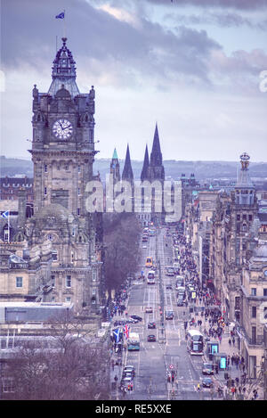 Edinburgh, Scotland / United Kingdom - 13 January 2019: Princes Street in the Centre of Edinburgh is busy with buses and shoppers in front of the Balm - Stock Photo
