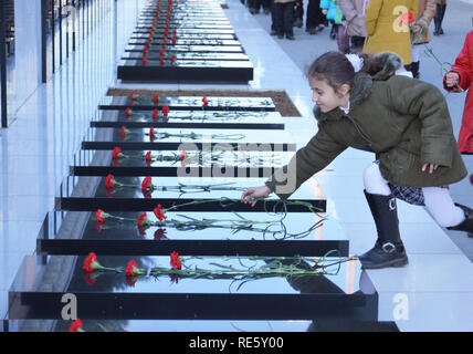 Azerbaijan, Baku, January 20, 2011. People visiting Alley of Martyrs on anniversary of 20th January tragedy when Soviet Army attacked Baku in 1990, ki - Stock Photo