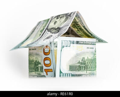 A house of paper dollars on a white background. - Stock Photo