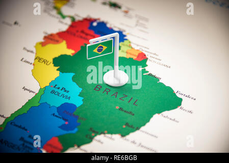 Brazil marked with a flag on the map - Stock Photo