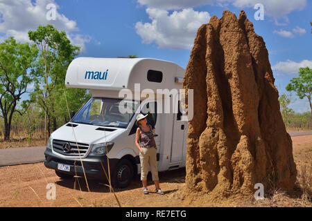 Motorhome tourist stops on the road side to look at a cathedral termite mound one of most iconic sites in Kakadu Northern Territories Australia - Stock Photo