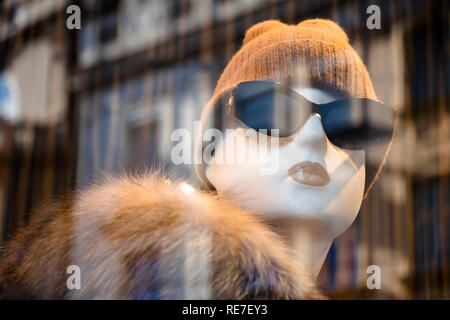 Belgrade, Serbia - Januar 17, 2019: One mannequin doll in winter outfit displayed n the shop window of Max Mara clothing expensive and elegant brand w - Stock Photo