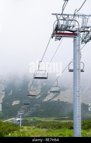 Mountain chairlift. An elevated passenger ropeway. - Stock Photo