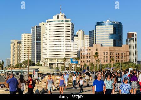 Tourists on the promenade in Charles Clore Park along Alma Beach, Tel Aviv, Israel - Stock Photo