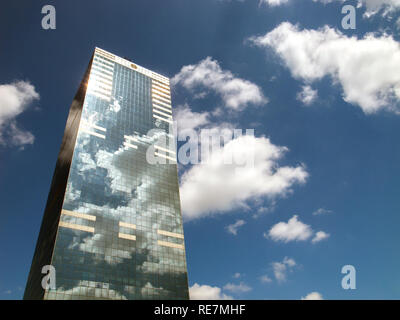 Reflection of sky in windows of office building, Brussels, Belgium - Stock Photo