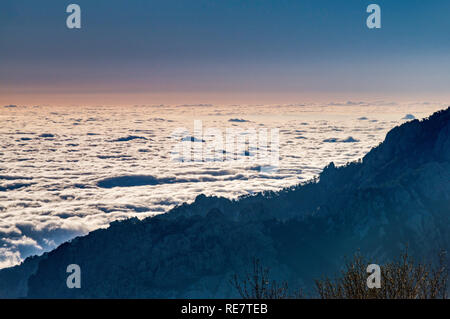Low clouds over Fium Orbo valley, early morning, view from Gite d'etape U Fugone, mountain hut at Monte Renoso trailhead, Haute-Corse, Corsica, France - Stock Photo